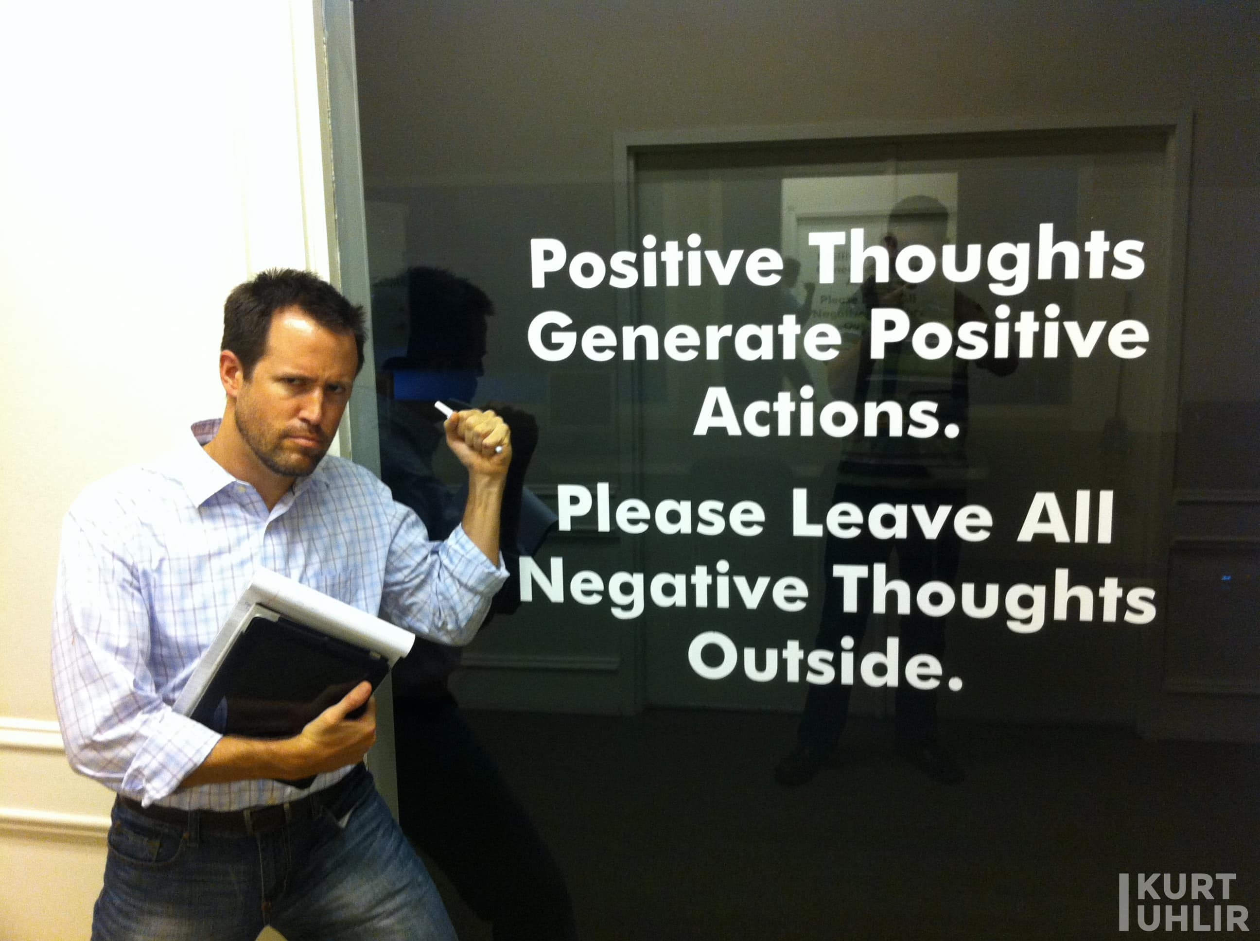 Kurt Uhlir having fun while doing customer discovery. Sign - Positive thoughts generate positive actions. Please leave all negative thoughts outside.